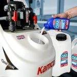 adding cleaning fluid to a power flush